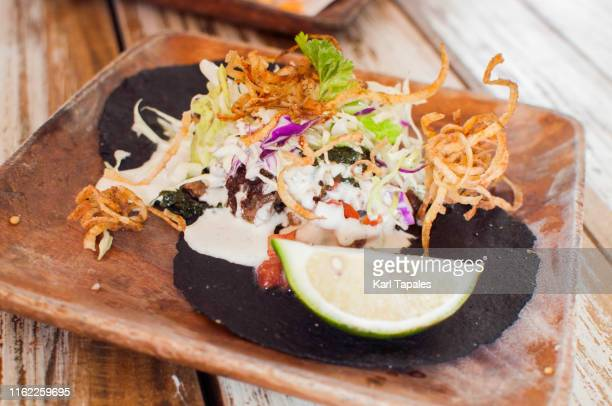 beef barbacoa on a squid ink tortilla - capital region stock pictures, royalty-free photos & images