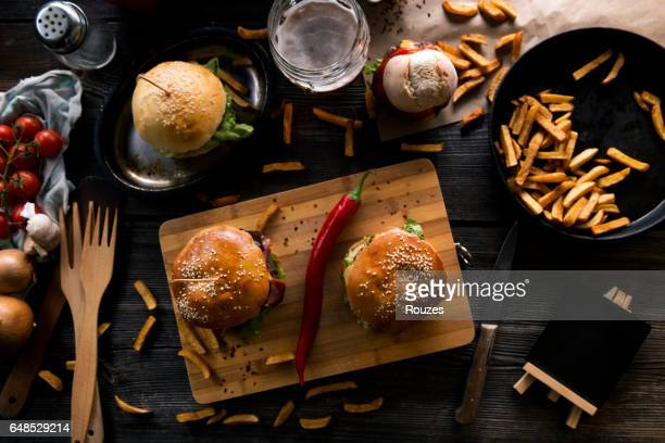 beef burgers - wood table top stock photos and pictures