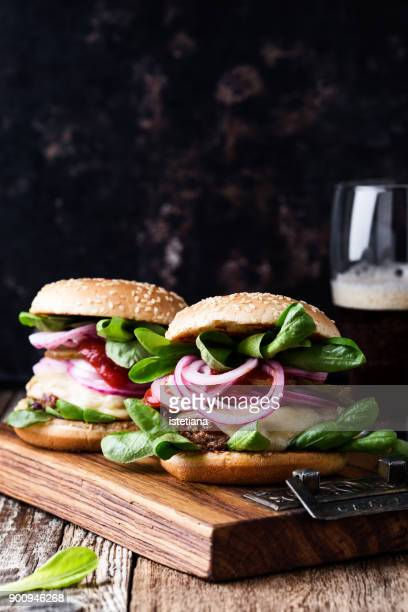 Beef burgers with pickled red onion and gherkins