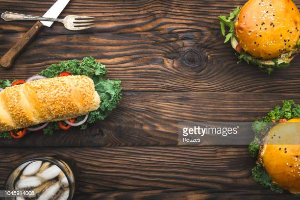 beef burgers with sandwich, glass of cola and space on text - wallpaper roll stock pictures, royalty-free photos & images