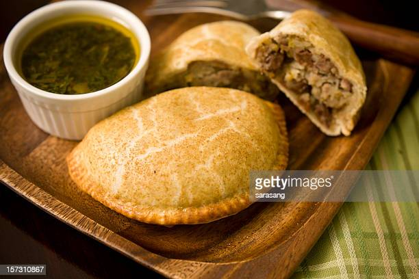 beef empanada on a wooden plate ready to eat - savory food stock pictures, royalty-free photos & images