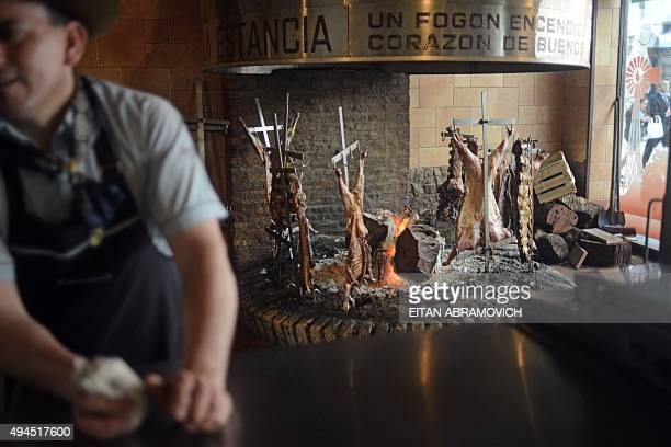 Beef is roasted in a traditional grill restaurant in Buenos Aires on October 27 2015 Sausages ham and other processed meats cause bowel cancer and...