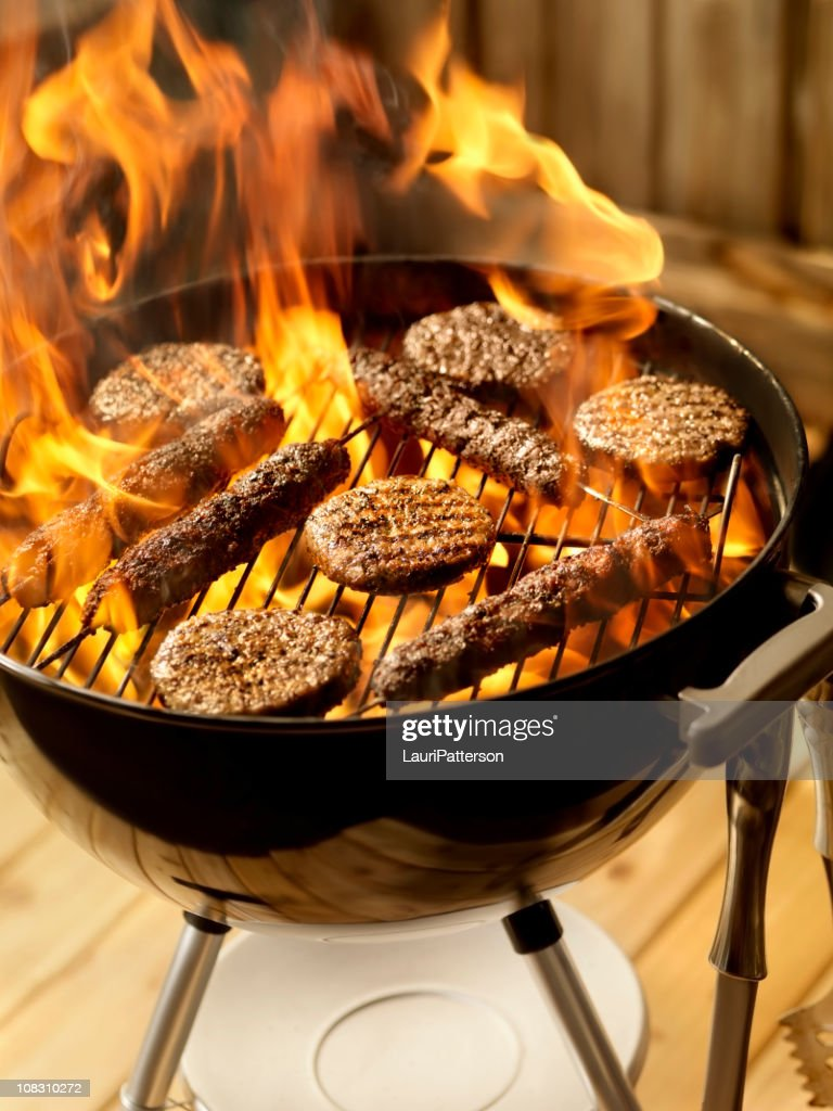 Beef Kabobs and Burgers on a Charcoal BBQ : Stock Photo
