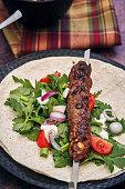 beef kebab with flatbread vegetable green