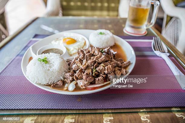 Beef Lok-lak served with beer