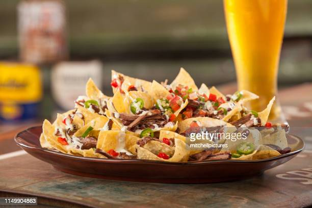 beef nachos and beer - nachos stock pictures, royalty-free photos & images
