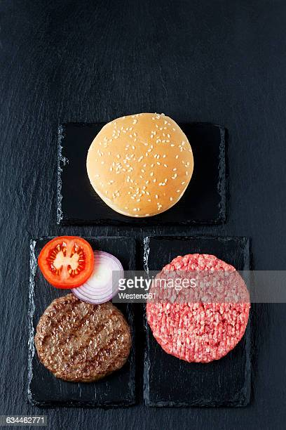 Beef patties with tomato, onion rings and bun