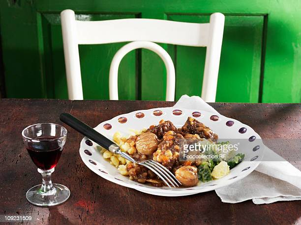 Beef ragout with sweet chestnuts and port wine on table