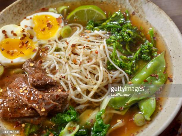 beef ramen noodle and vegetable soup with a soft boiled egg - soy sauce stock photos and pictures