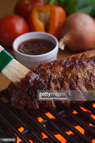 beef ribs on bbq - basting brush stock photos and pictures