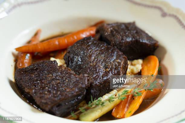 beef short ribs with carrots and herbs - course meal stock pictures, royalty-free photos & images