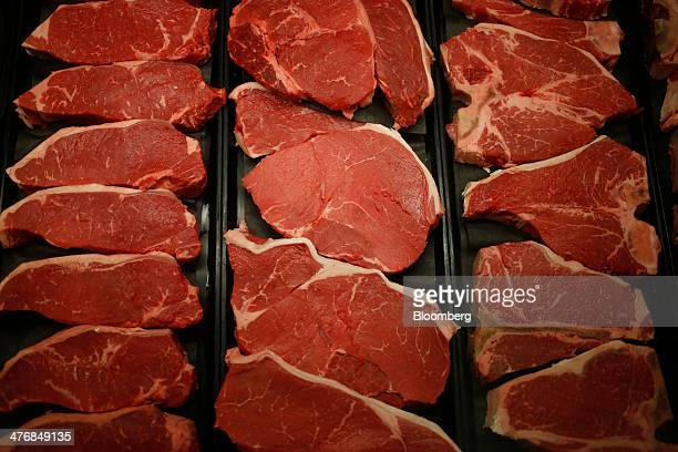 Beef sirloin steaks are displayed behind the meat counter at a Publix Super Markets Inc grocery store in Knoxville Tennessee US on Wednesday March 5...