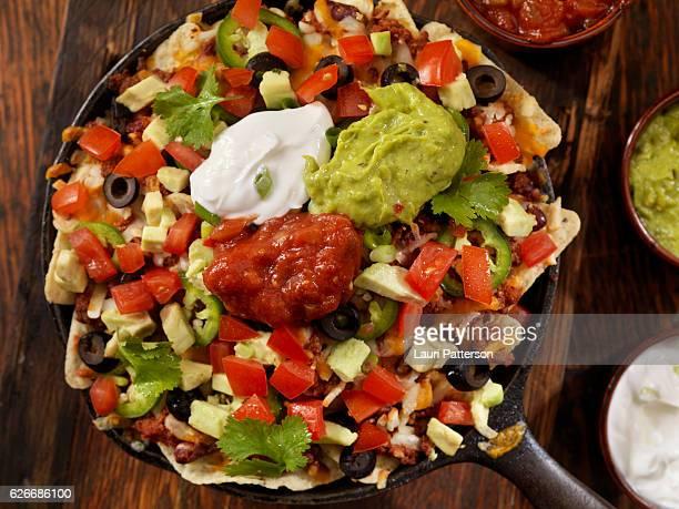 beef skillet nachos - nachos stock photos and pictures