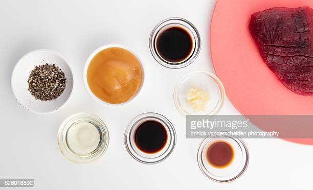 beef steak marinade ingredients and beef steak. - soy sauce stock photos and pictures