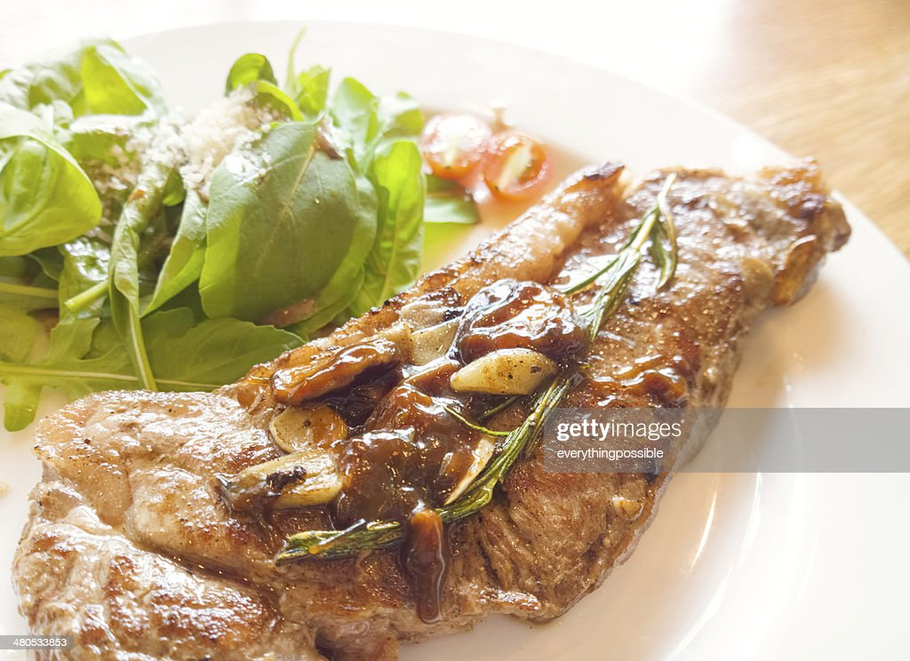 beef steak on wooden table : Stock Photo