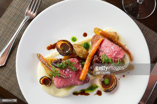 Beef steak with carrots and onions