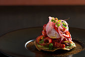 beef tostada with pickeled onions peppers