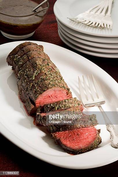 Beef tenderloin with porcini sauce makes an impressive presentation for holiday dinners and can feed a crowd with not a lot of fuss