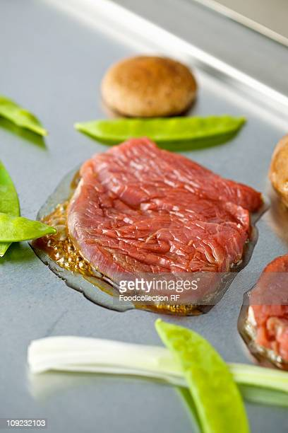 Beef teppan yaki with mangetout, close-up