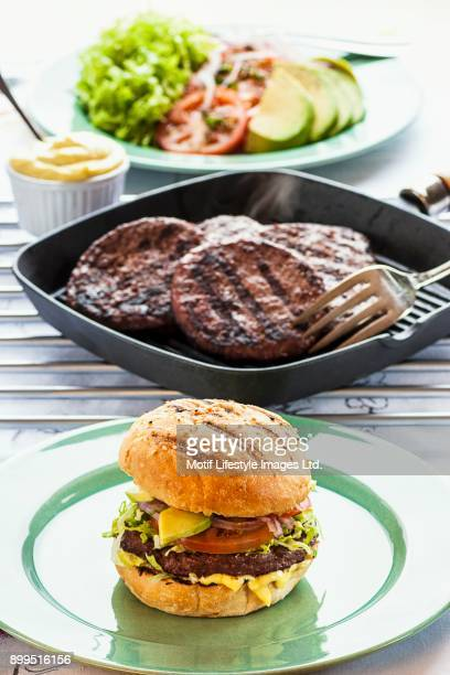 A beefburger with salad and aioli