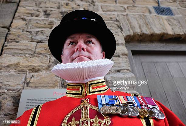 A beefeater stands on guard ahead of the arrival of Queen Elizabeth II and Prince Andrew Duke of York at the amalgamation parade of The Queen's Royal...