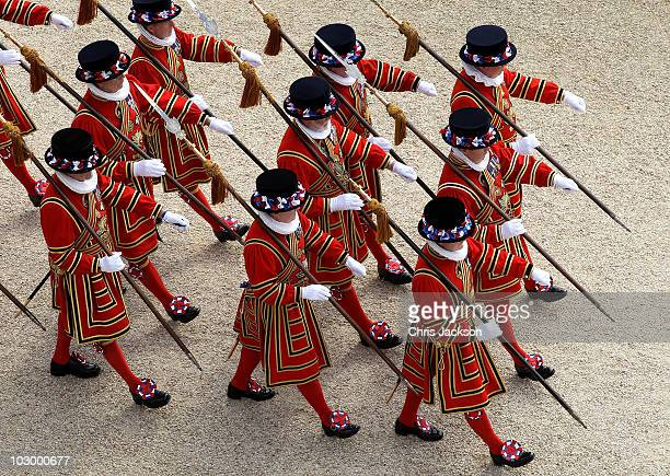 Beefeaters march in the gardens of Buckingham Palace during a garden party hosted by the Queen on July 20 2010 in London England