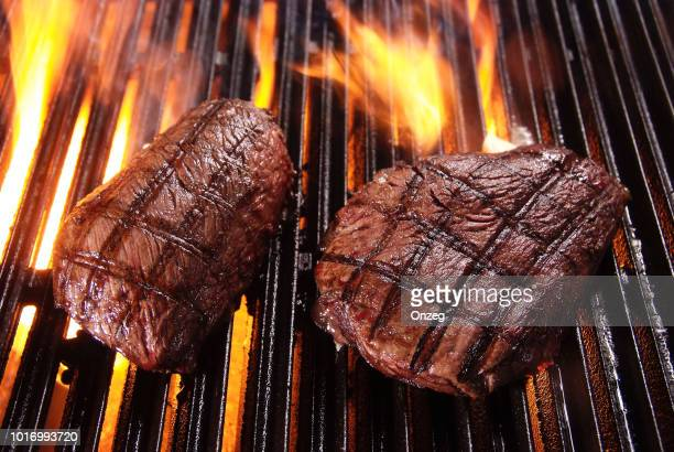 beefsteaks on barbecue grill - juicy stock photos and pictures