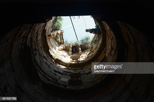 A beehive is visible on top of the 'well' at the 15th century Ambapur Ni Vav or Stepwell at the village of Ambapur some 30 kms from Ahmedabad on...
