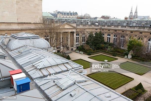 Beehives painted in the colours of the French national flag are installed on the roof of the Palais Bourbon on April 3 2013 in Paris France