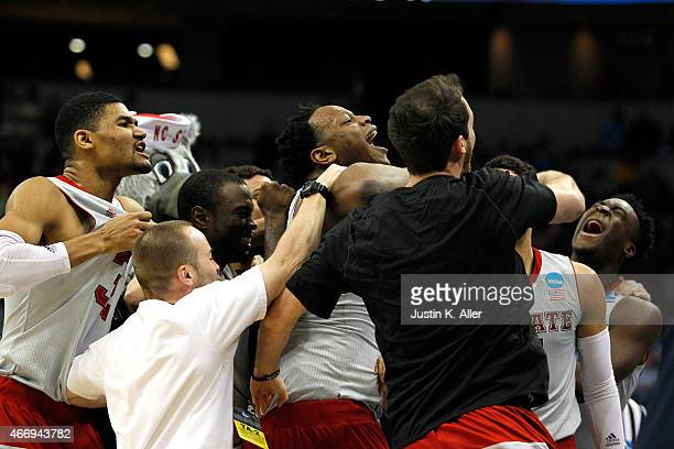 Beejay Anya of the North Carolina State Wolfpack celebrates with his teammates after hitting the game winning shot to defeat the LSU Tigers 66 to 65...