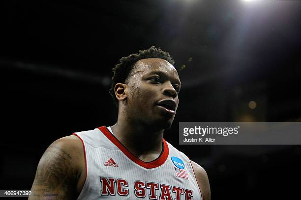 Beejay Anya of the North Carolina State Wolfpack looks on after defeat the LSU Tigers 66 to 65 during the second round of the 2015 NCAA Men's...
