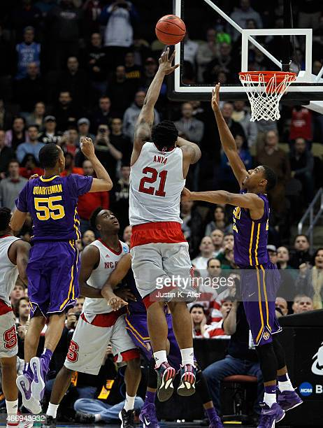 Beejay Anya of the North Carolina State Wolfpack shoots the game winning shot to defeat the LSU Tigers 66 to 55 during the second round of the 2015...