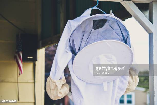 beekeeper suit hanging outdoors. - africanized killer bee stock pictures, royalty-free photos & images
