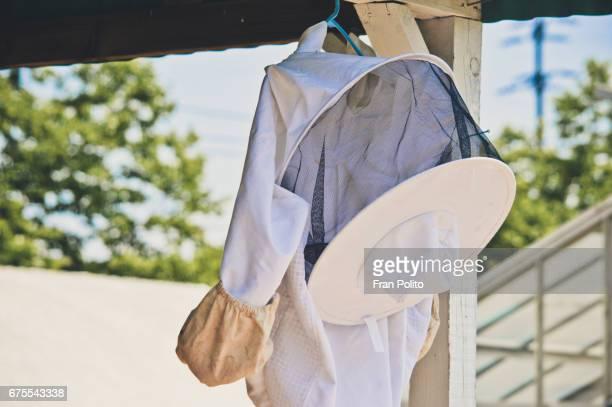 Beekeeper suit hanging outdoors.