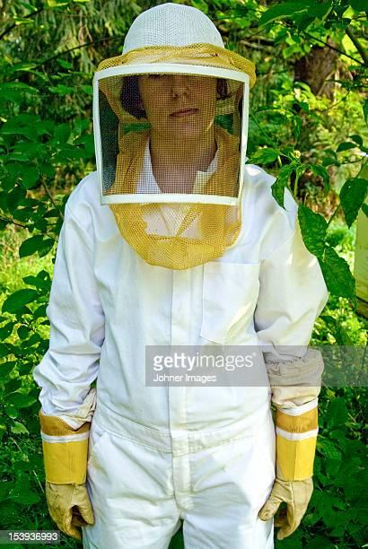 Beekepper wearing protective workwear