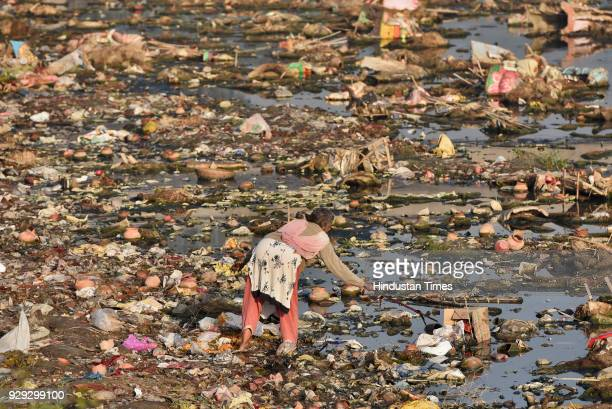 Beena Omprakash a rag picker collects waste from Yamuna River on March 8 2018 in New Delhi India Omprakash collects the waste and sells only after a...