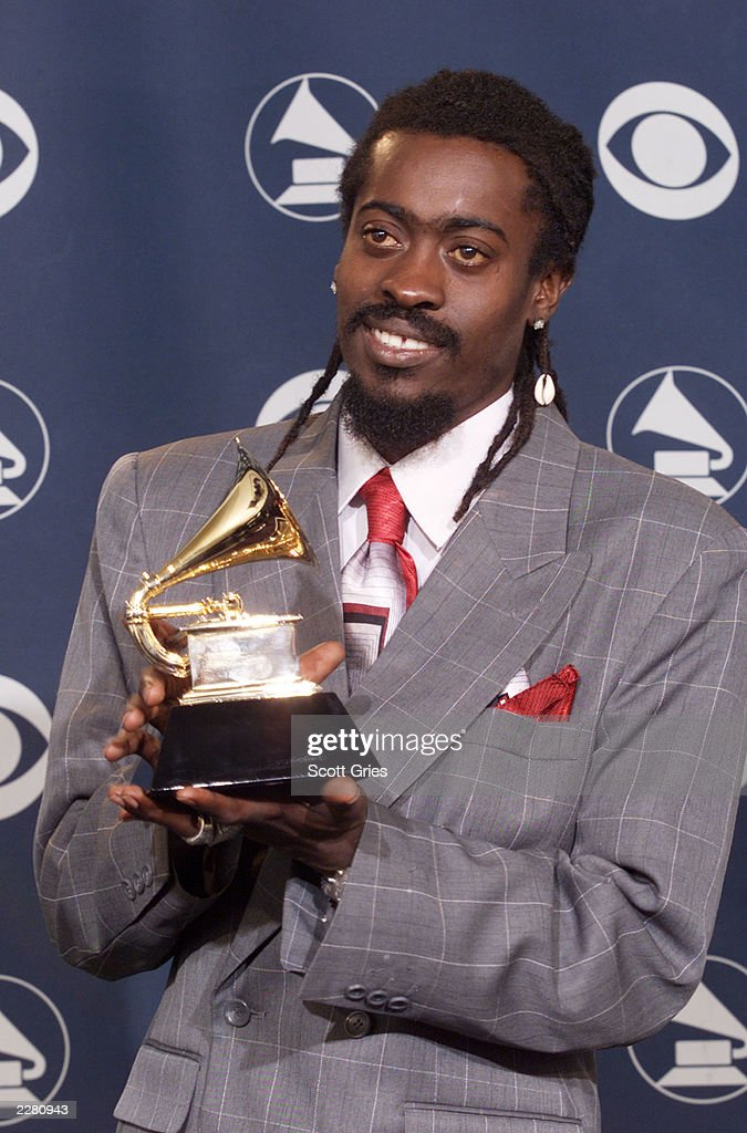 Beenie Man holds Grammy he received for Best Reggae Album backstage... News  Photo - Getty Images