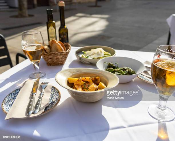 beer and bread on a terrace - 副菜 ストックフォトと画像