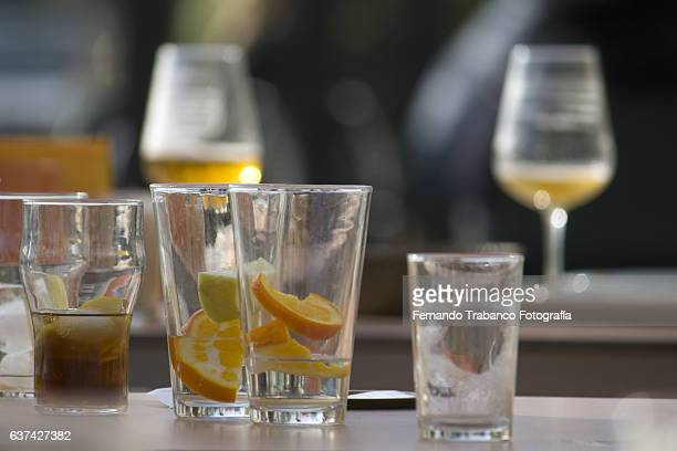beer and cocktail glasses on a table - table after party stock pictures, royalty-free photos & images