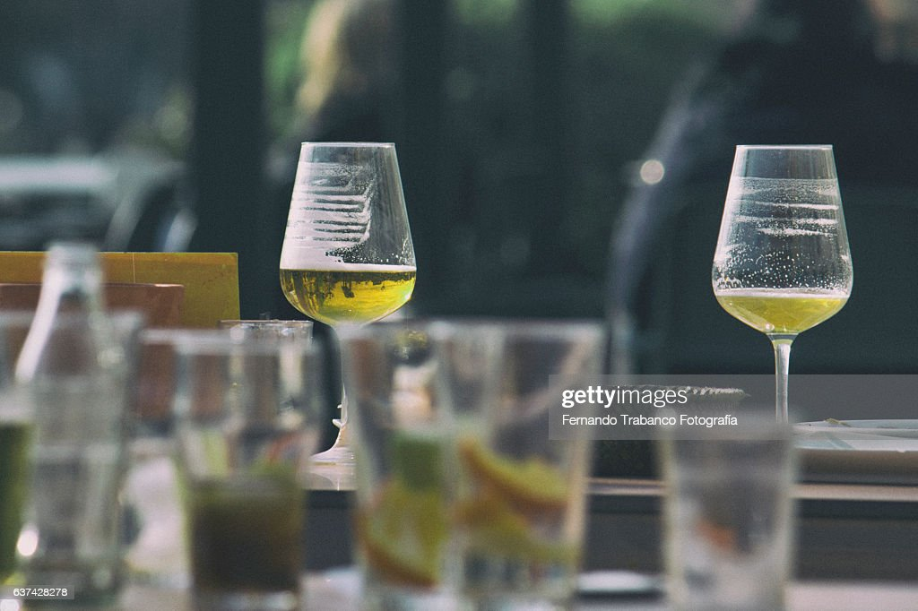 Beer and cocktail glasses on a table : Stock Photo