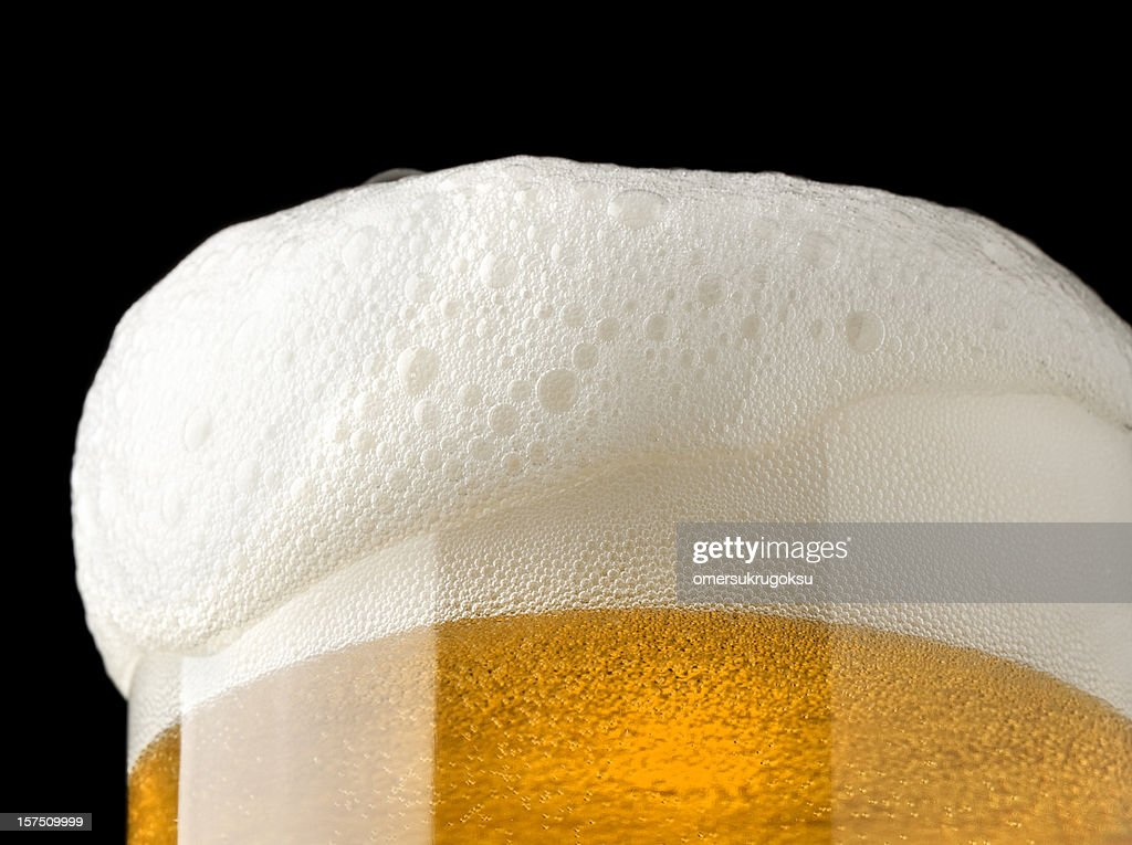 beer and froth : Stock Photo