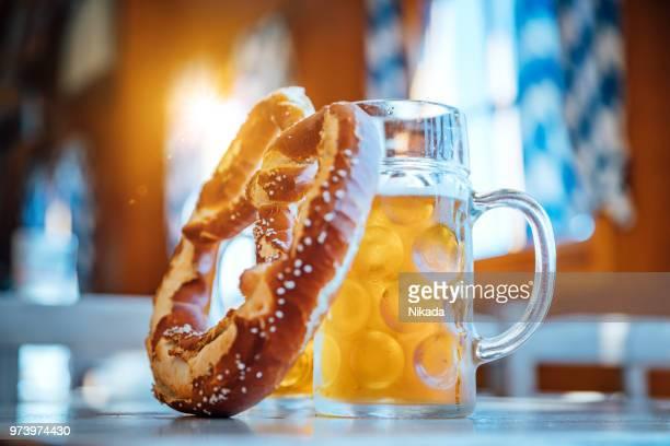 beer and pretzel, oktoberfest munich, germany - baviera foto e immagini stock