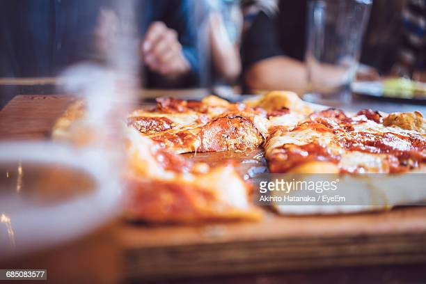 Beer And Rustic Pizza Served On Table