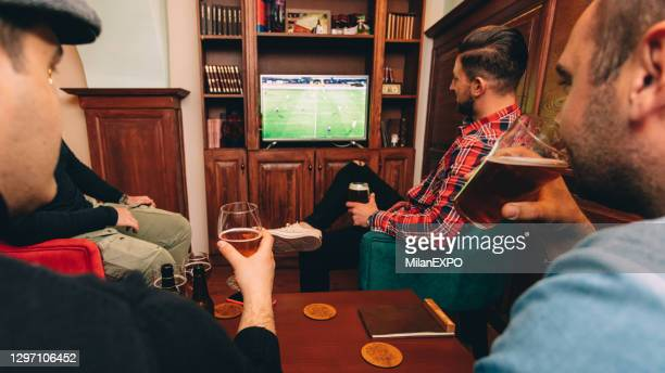 beer and soccer at the pub - supporter stock pictures, royalty-free photos & images