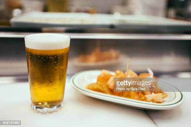 beer and spanish tapa - tapas stock photos and pictures