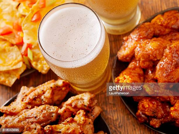 beer and wings - appetizer stock pictures, royalty-free photos & images