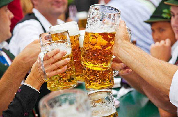 beer at oktoberfest in munich, germany - germany stock pictures, royalty-free photos & images