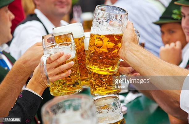 beer at oktoberfest in munich, germany - duitsland stockfoto's en -beelden