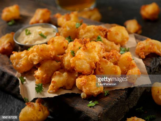 beer battered cheese curds with dipping sauce - fried stock pictures, royalty-free photos & images
