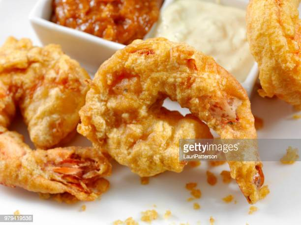 beer battered tiger prawns with dipping sauce - breaded stock photos and pictures